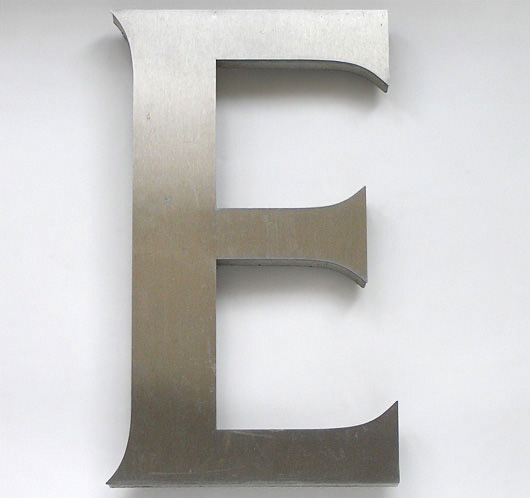 Large vintage brushed steel sign letter 'E'