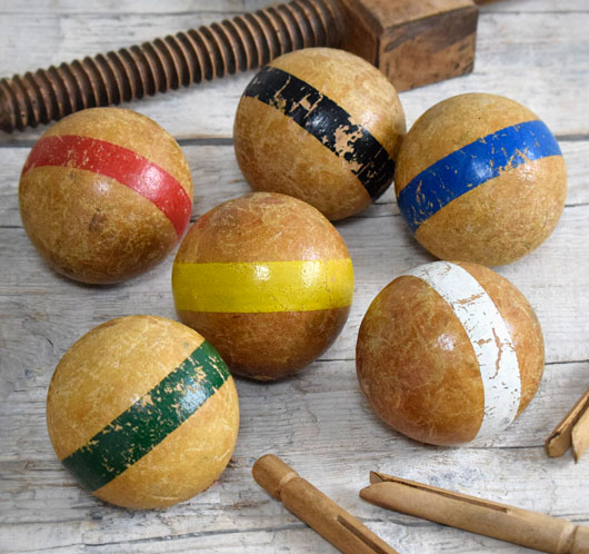 Group of antique wooden game balls