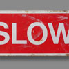 Large late-1900s painted tin road sign: Slow
