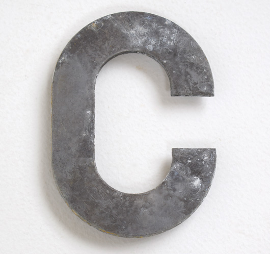 Early vintage cast-metal car number plate letter 'C'