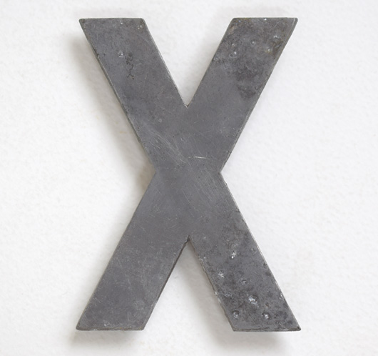 Early vintage cast-metal car number plate letter 'X'