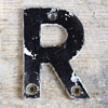 Mid-1900s monochrome metal sign letter 'R'