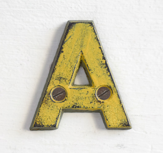 Antique Victorian painted yellow iron sign letter: A