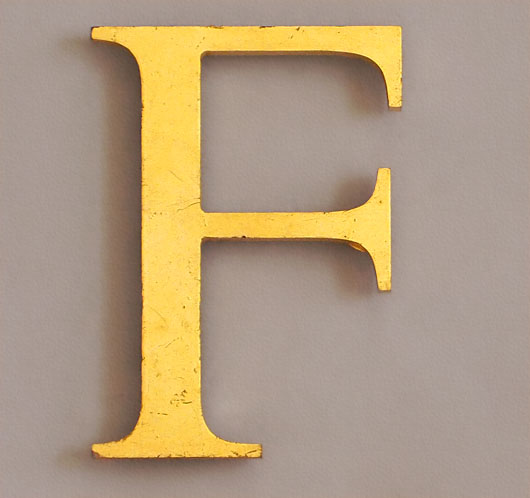 Small vintage gold-gilded perspex letter 'F', late-1900s