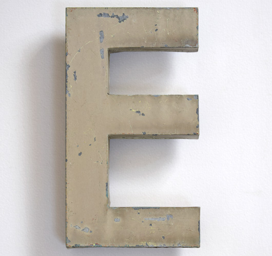 Early-1900s vintage French painted zinc sign letter 'E'