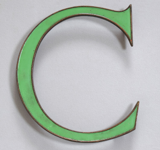 Vintage green enamel and brass sign letter 'C', c. 1910