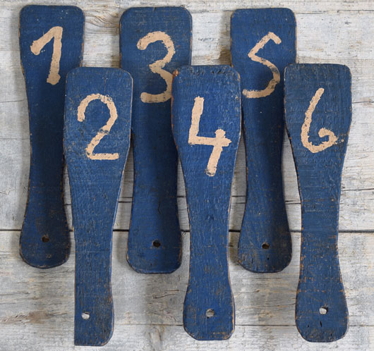 Group of antique wooden auction bidding paddles, 1 - 12