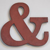Chocolate-brown wooden ampersand symbol