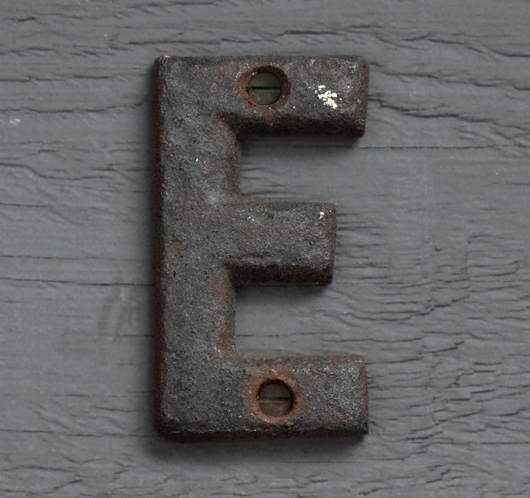 Small antique iron sign letter 'E'