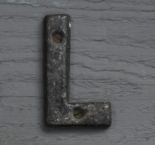 Small antique iron sign letter 'L'