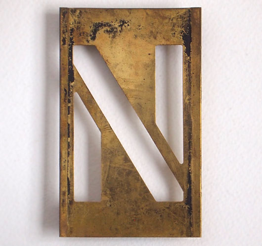 Early-1900s vintage brass plate letter stencil: 'N'