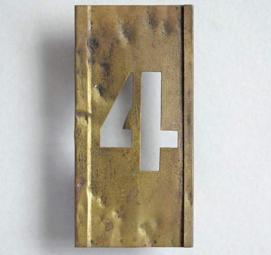 Early-1900s vintage brass number stencil: '4'