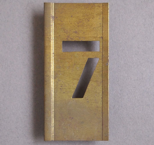 Early-1900s vintage brass number stencil: '7'