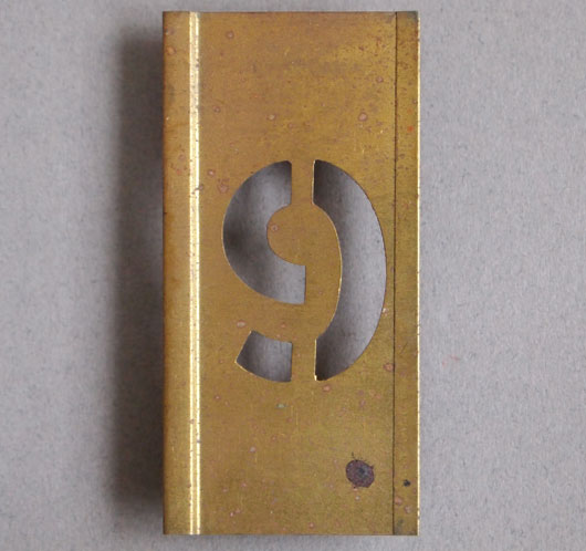 Early-1900s vintage brass number stencil: '9'