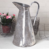 Tall zinc water jug with paint streaks