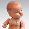 Age-worn antique celluloid doll, c. 1900
