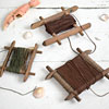 Trio of antique wooden fishing hand lines