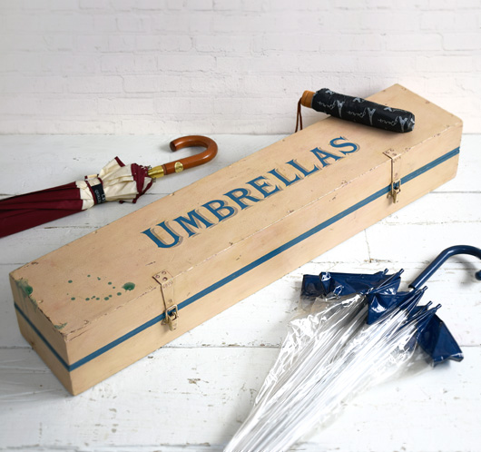 Early-1900s elongated wooden chest: Umbrellas