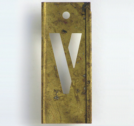 Early-1900s vintage interlocking brass letter stencil: 'V'