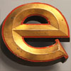 Lowercase gold-gilt pub sign letter 'e', early 1900s