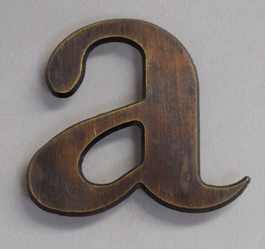Small vintage cast-bronze lowercase letter 'a', c. 1920s