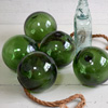 Green glass fishing float, early 1900s