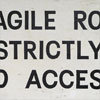 Painted wooden sign: Fragile Roof...
