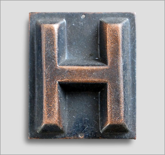 Small embossed brass door sign letter 'H', c. 1900