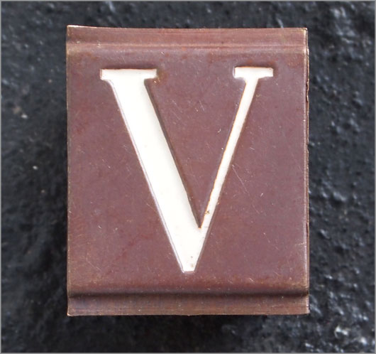 Small vintage enamelled brass door sign letter 'V'