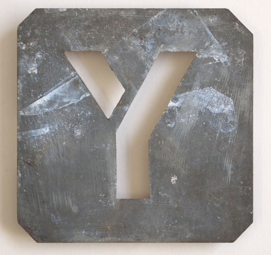 Early-1900s vintage zinc plate letter stencil 'Y'