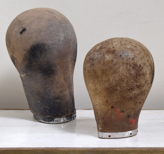 Early-1900s antique linen and wood dummy heads