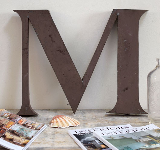 Large vintage metal shop sign letter 'M', early 1900s
