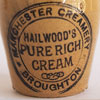 Small stoneware cream jar: Hailwood's, Manchester