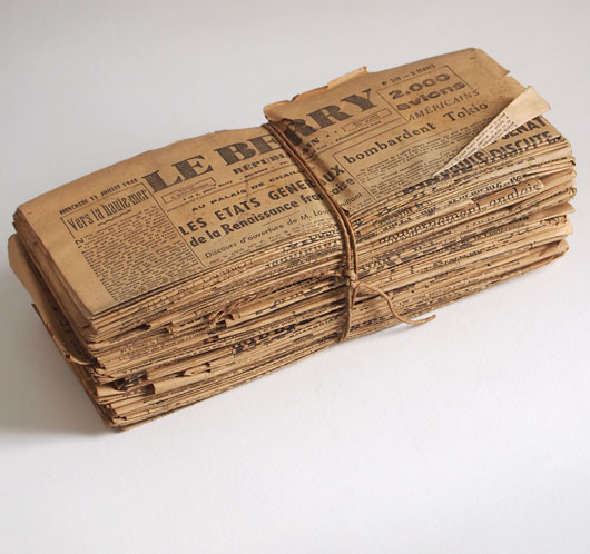 Tied bundle of 1940s antique French newspapers