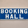 Early-1900s cast-iron sign: Booking Hall