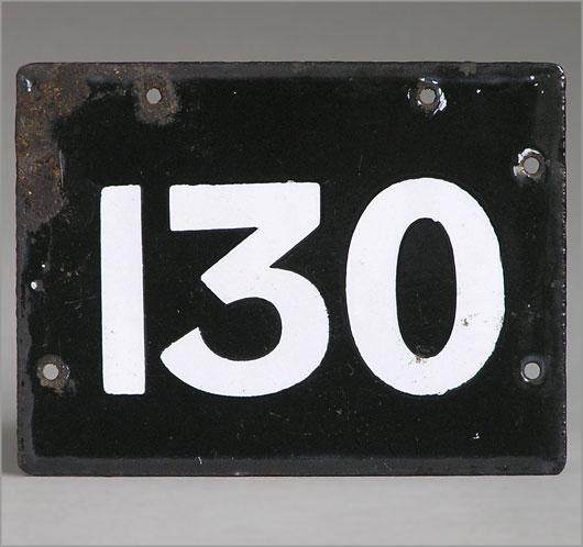 Black and white enamel number plaque sign '130'