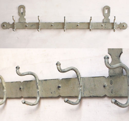 The vintage wall row of painted decorative iron coat hooks - Cast iron row of hooks ...