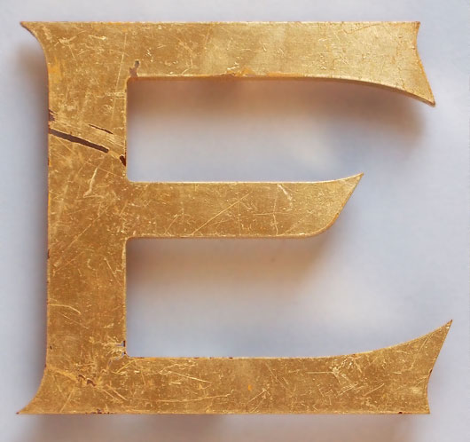 Gold-gilded vintage perspex store sign letter 'E'