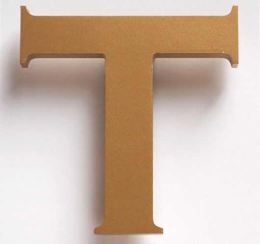 Vintage pub sign painted gold letter 'T'