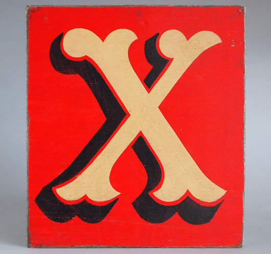 Hand-painted reclaimed wooden sign: fairground letter 'X'