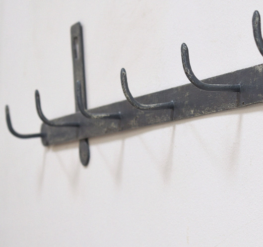The vintage wall painted 19th century iron row of hooks - Cast iron row of hooks ...