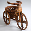 Early-1900s cane tricycle plant basket