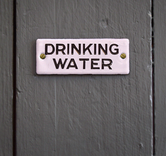 Small vintage monochrome enamel sign: Drinking Water