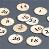 Group of vintage tin-lined paper number discs (13)