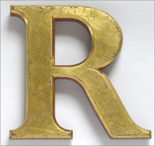 gold letter r gold and red pub sign letter