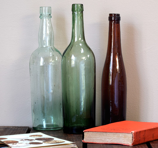 Trio of antique Victorian glass beverage bottles