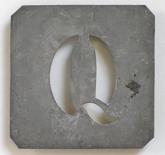 Early-1900s vintage French zinc metal letter stencil: 'Q'
