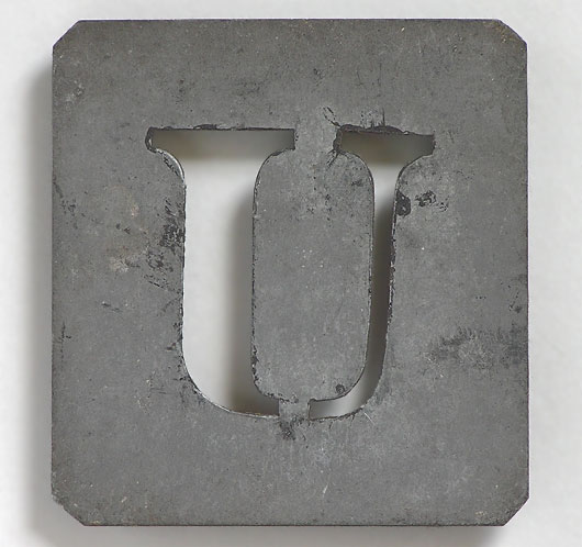 Early-1900s vintage French zinc metal letter stencil: 'U'