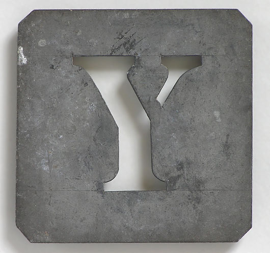 Early-1900s vintage French zinc metal letter stencil: 'Y'