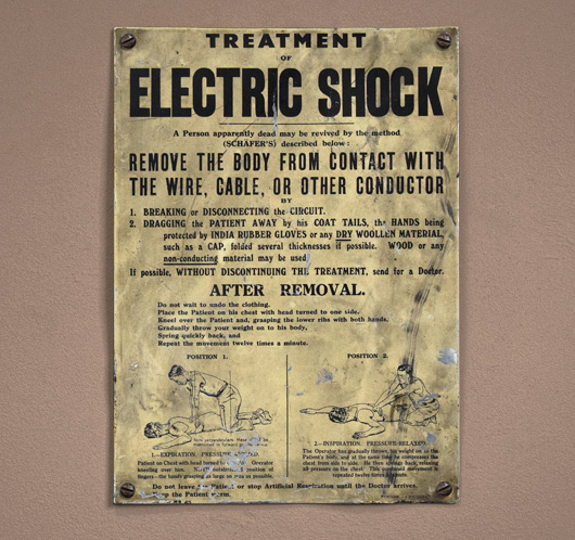 1940s vintage tin sign: Treatment Of Electric Shock